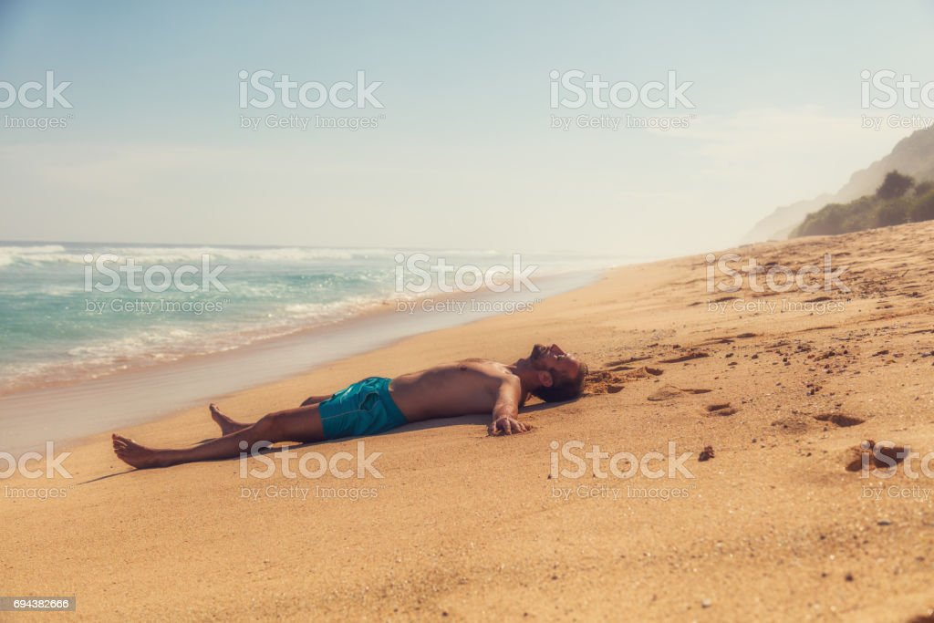 Man enjoying on empty tropical exotic beach. stock photo