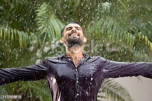 Drenched man enjoying a rainy day