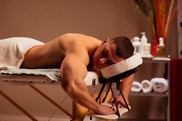 Man enjoying,  relaxing after massaging at health spa treatment. stock photo