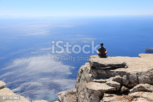 sea, earth, sky, mountains, meditating, sitting, looking at viewe