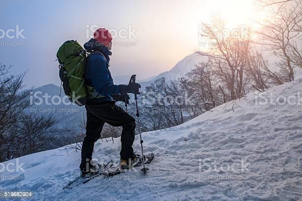 Man enjoys sunrise while snowshoeing through a forest picture id519682924?b=1&k=6&m=519682924&s=612x612&h=vh gswgkgfnulhbc2ei12d la5plqupfezhakrap h4=