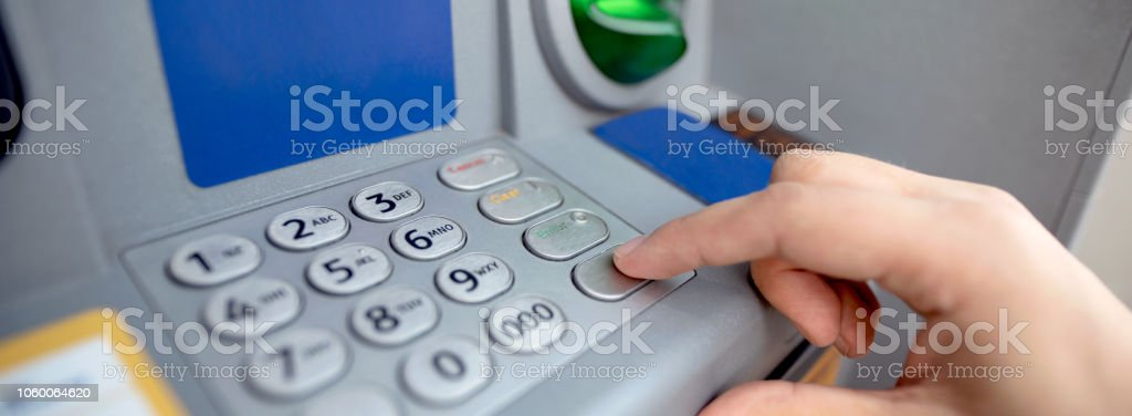 Man Entering Code On Atm Close Up Of Keypad Stock Photo