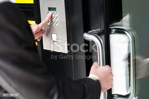 istock Man entering security code to unlock the door 502136157