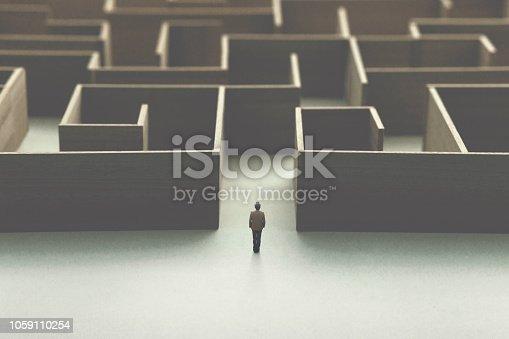man lost in a complex maze, surreal concept