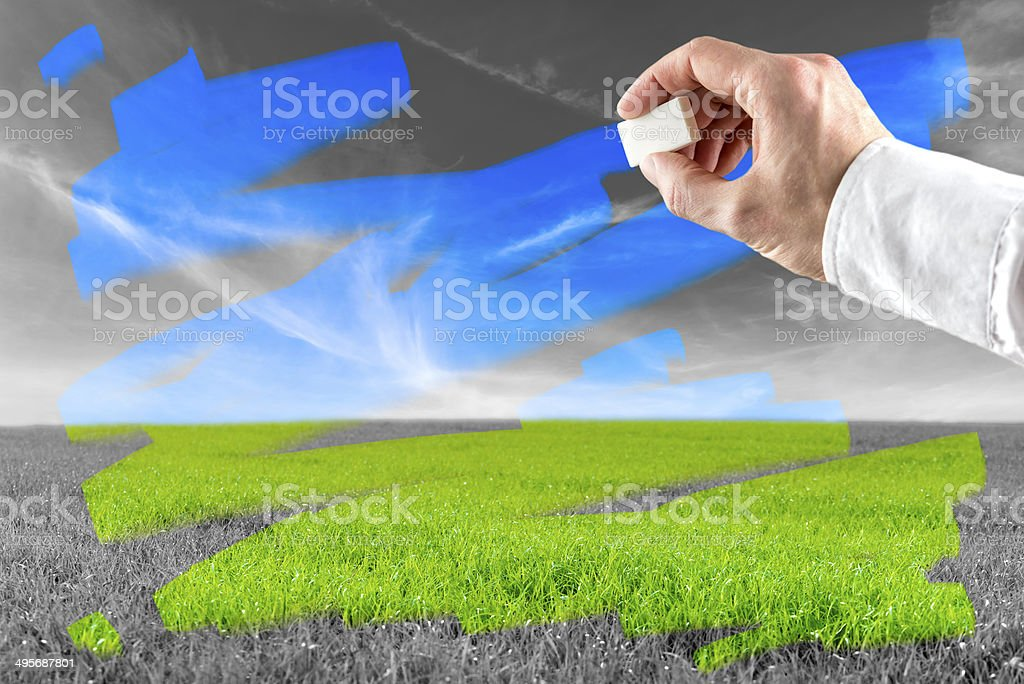 Man erasing pollution stock photo