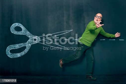 istock Man escaping from cuts 170061013