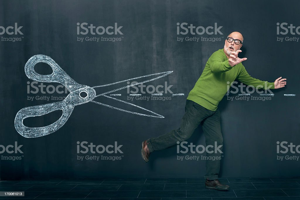Man escaping from cuts stock photo