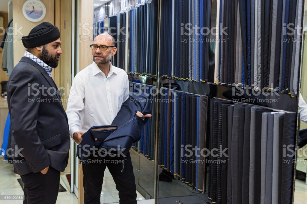 Man Examining Fabric for a Luxury Custom Made Suit royalty-free stock photo