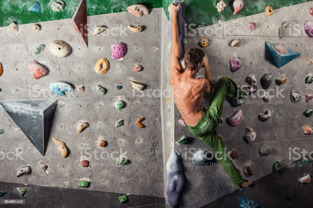 man exercise bouldering and climbing indoor stock photo