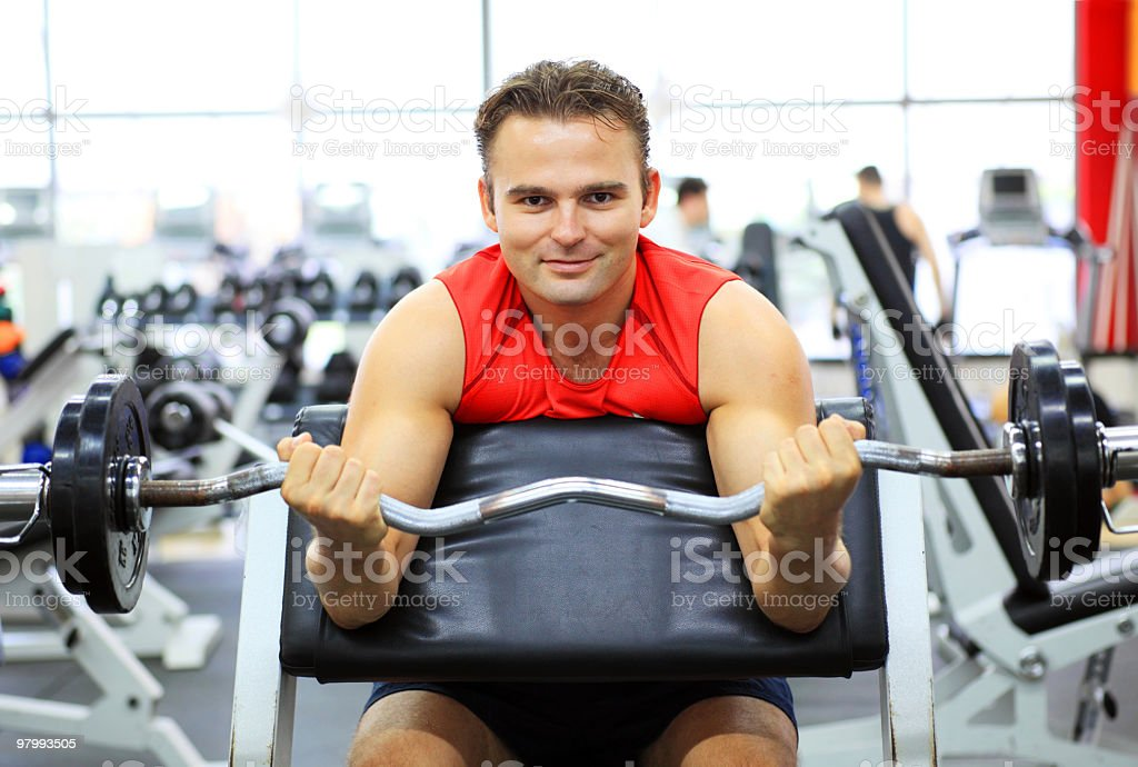 Man exercising at the gym using a barbell . royalty free stockfoto