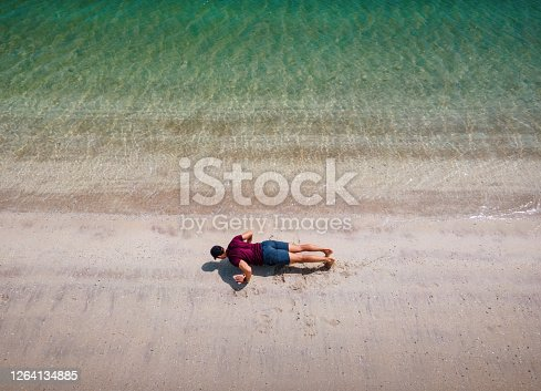 Man Exercising, Doing Push Up Exercises On the Beach Aerial view. Outdoor Fitness Workout