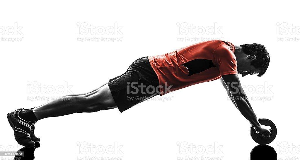 man exercising fitness workout abdominal toning wheel stock photo