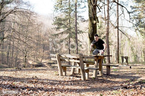 485902386 istock photo Man exercising in nature with bench 947323830