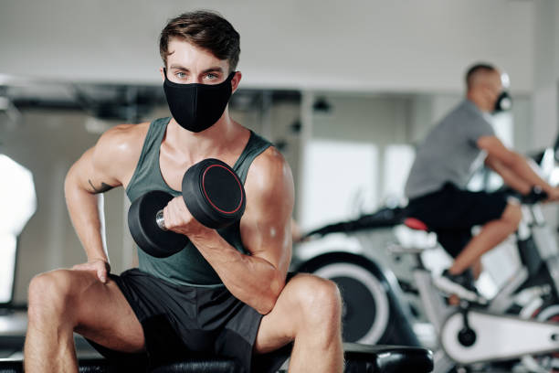 Man exercising in protective mask stock photo