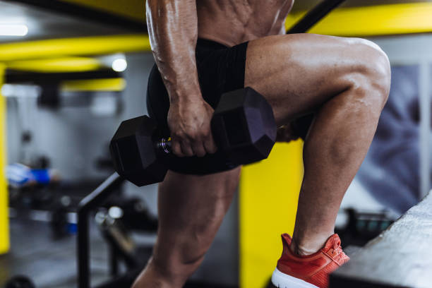 man exercising in the gym - milan2099 stock photos and pictures