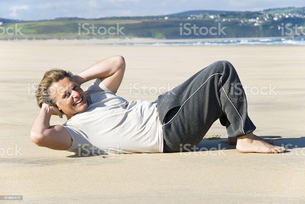 Man exercising on beach. royalty-free stock photo