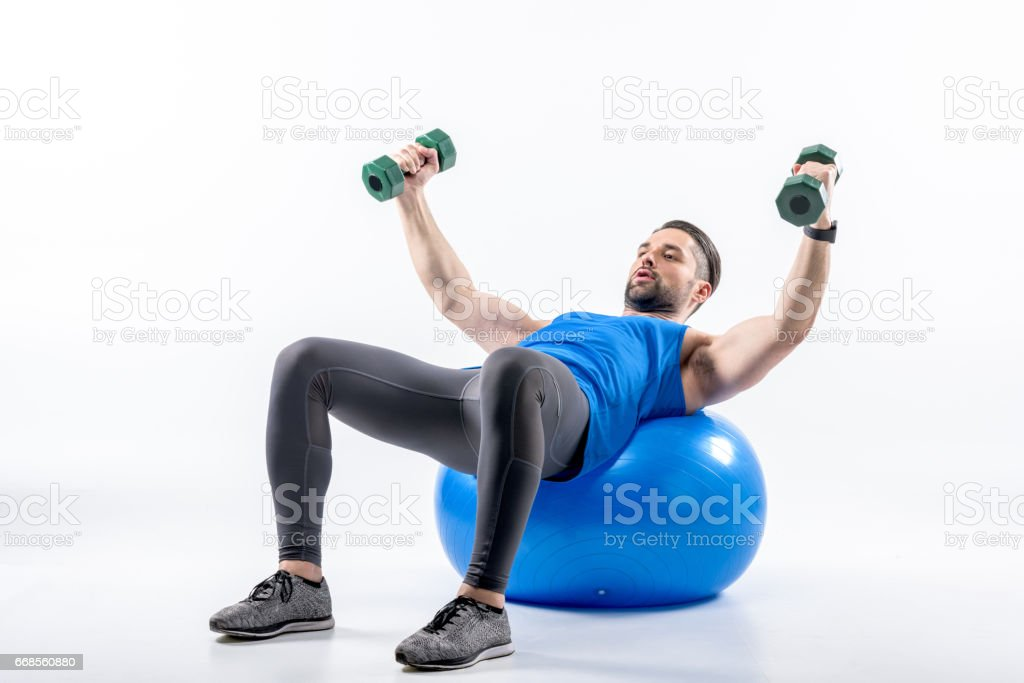 Man exercising on fit ball stock photo