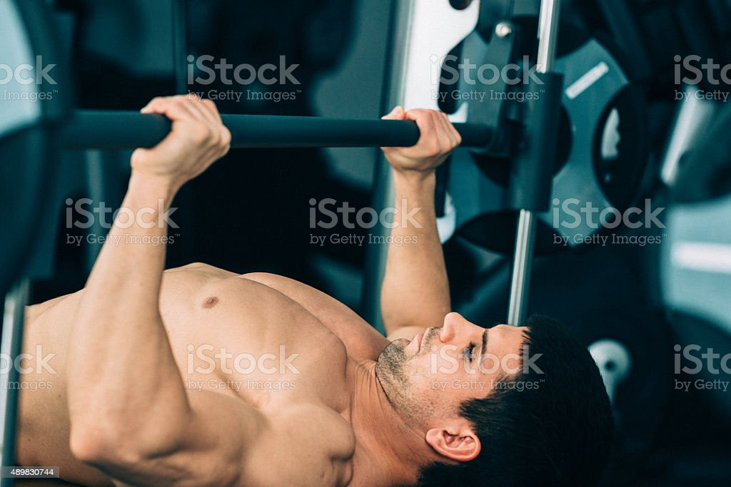 Man exercising on the bench press stock photo