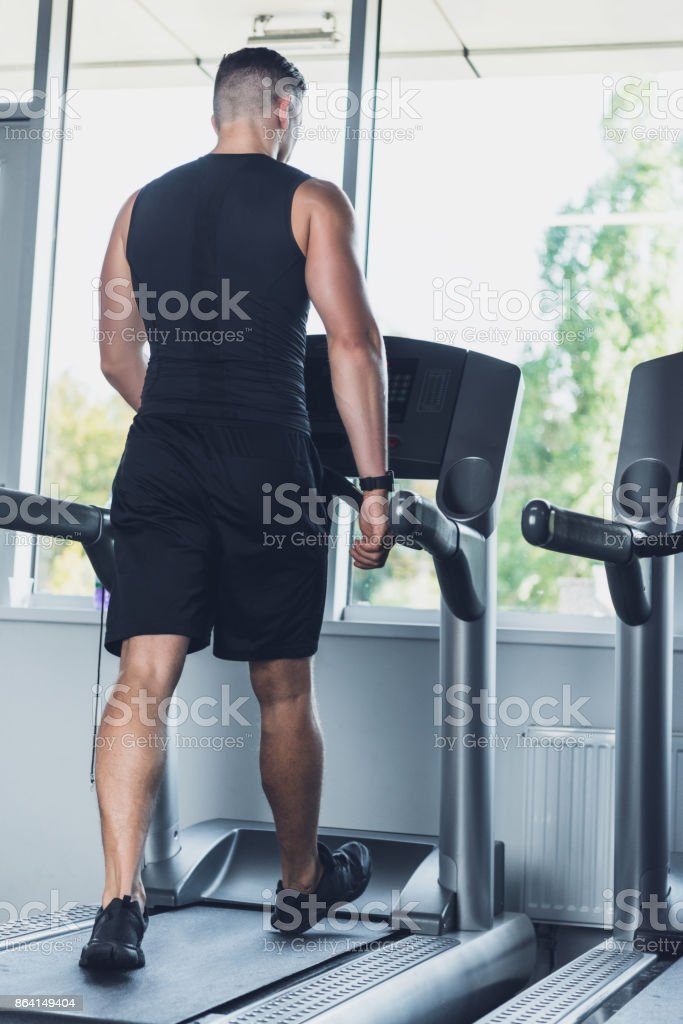 man exercising on treadmill royalty-free stock photo