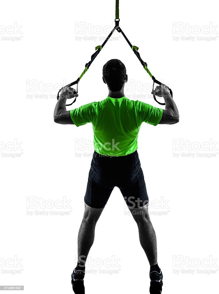 Hombre ejercicio de entrenamiento en suspensión trx silueta - Foto de stock de Adulto libre de derechos