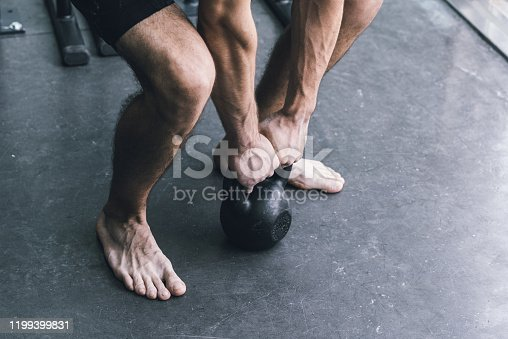 944655208 istock photo Man exercising with a kettlebell at the gym 1199399831