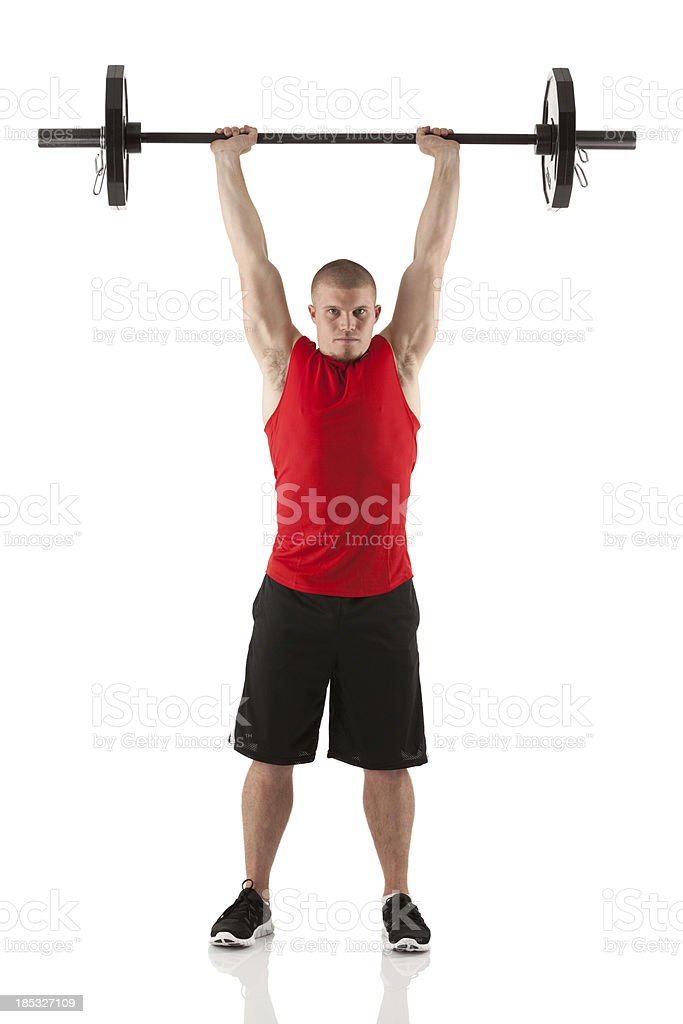 Man exercising with barbells royalty-free stock photo