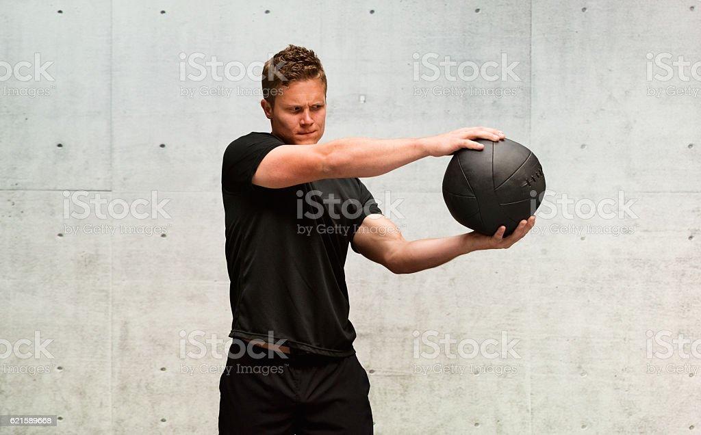 Man exercising with medicine ball stock photo