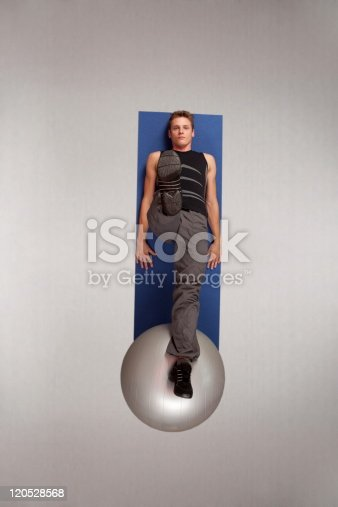 511849865 istock photo man exercising with  stability ball 120528568