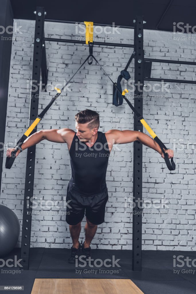 man exercising with trx gym equipment royalty-free stock photo