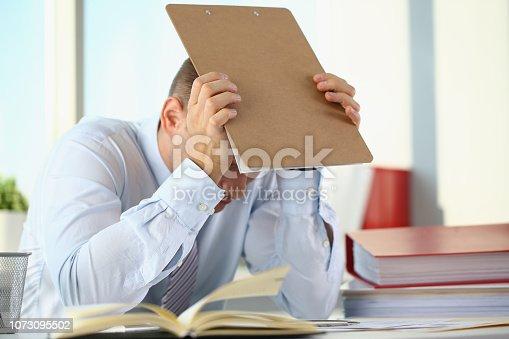 690496350istockphoto A man experiences stress and a headache 1073095502
