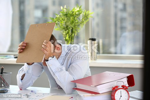 690496350istockphoto A man experiences stress and a headache 1073095506