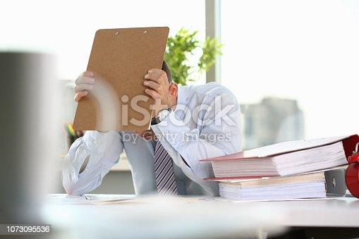690496350istockphoto A man experiences stress and a headache 1073095536