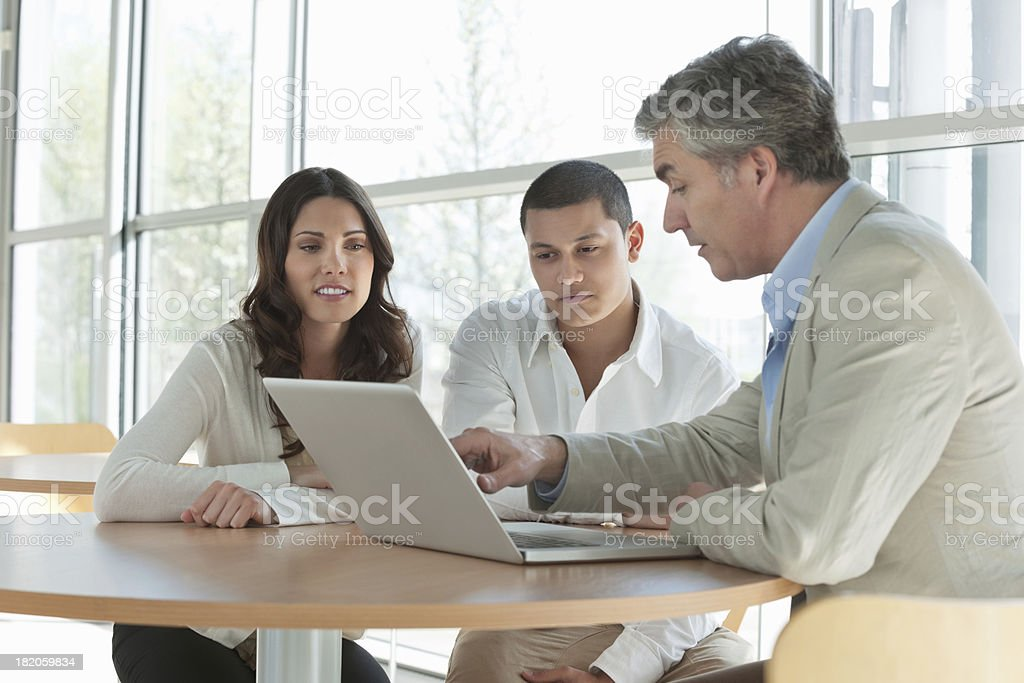 Man Explaining an Investment Plan To Couple stock photo