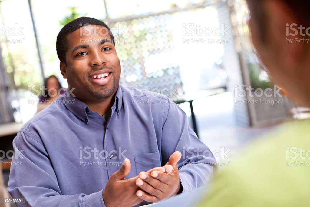 Man explaining something to colleague royalty-free stock photo