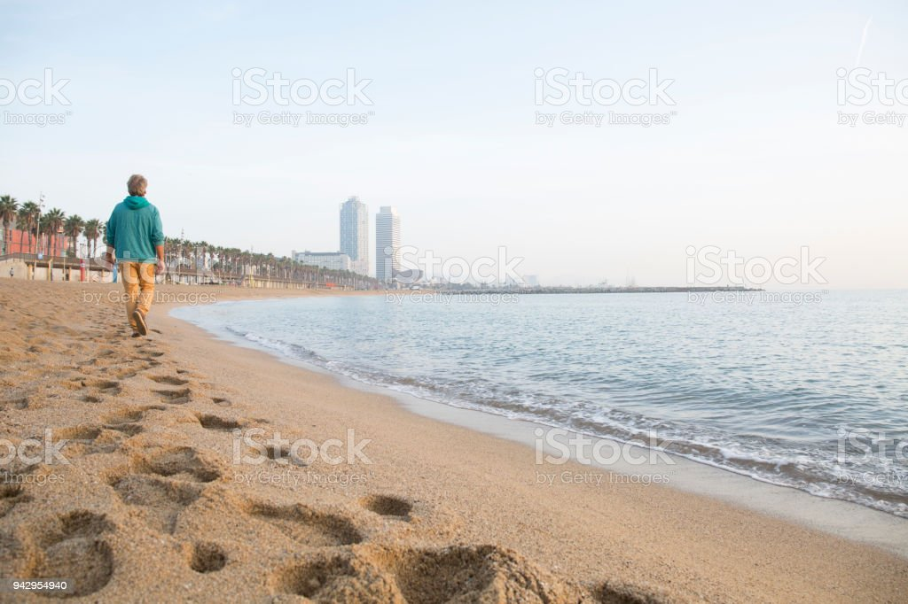 Man Explores Beach At Sunrise Barcelona Catalonia Stock ...