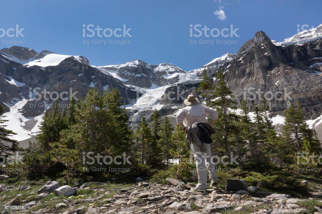 Man explores hikes Stanley Glacier Kootenay National Park British Columbia Canada stock photo