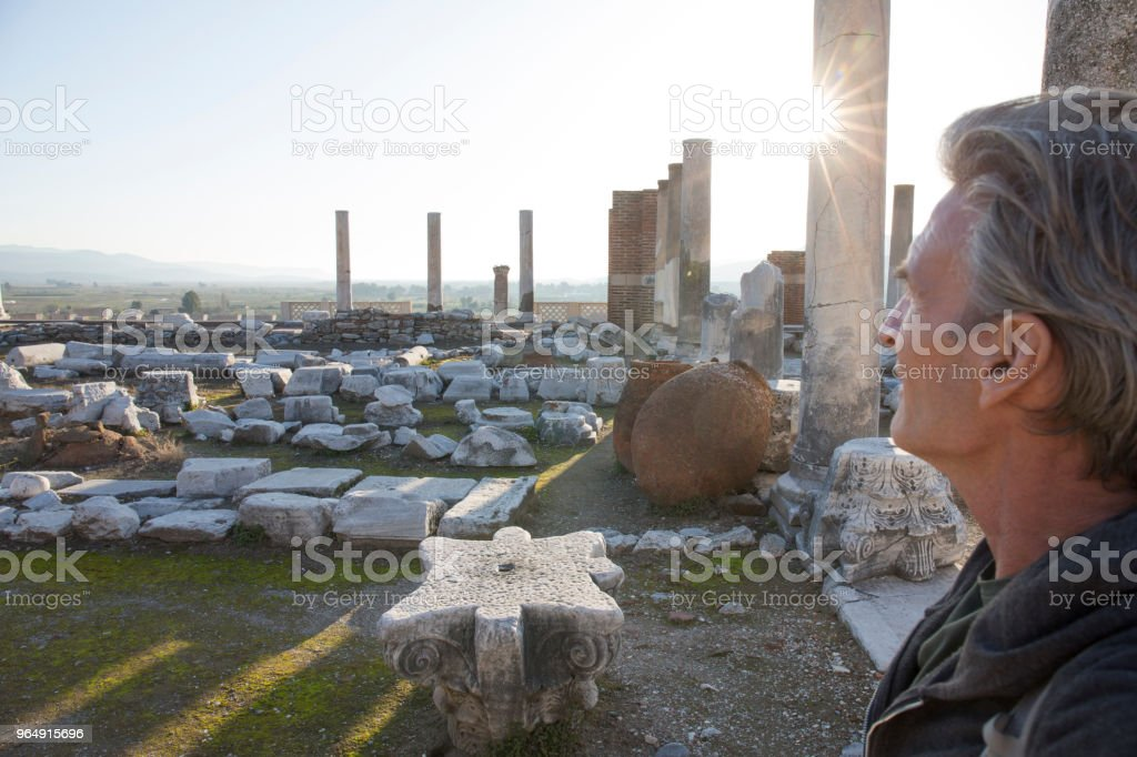 Man explores ruins on hill crest royalty-free stock photo