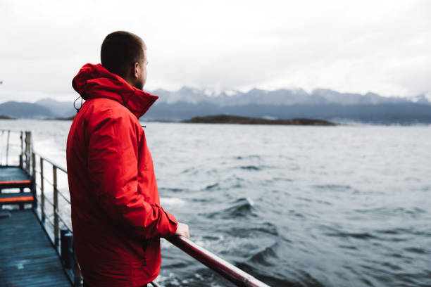 Man exploring the Beagle Channel in Ushuaia by cruise ship stock photo