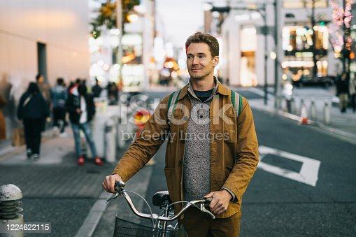 Man discovering the city with bicycle