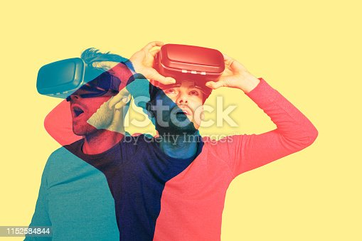 Young man wearing VR headset. Negative and positive emotions
