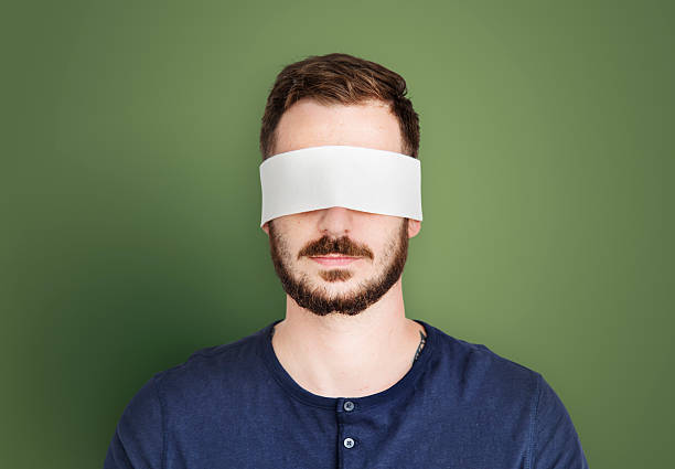 Man Eye Covered Blind Forbidden Lost Concept stock photo
