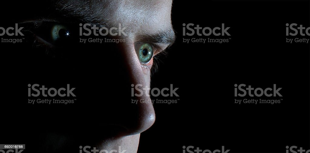 Man Face In A Black Background Low Key Serios Look Stock Photo