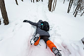 Man falling down on the snow road.