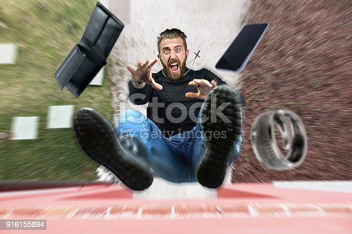 istock Man falling from the roof 916155894