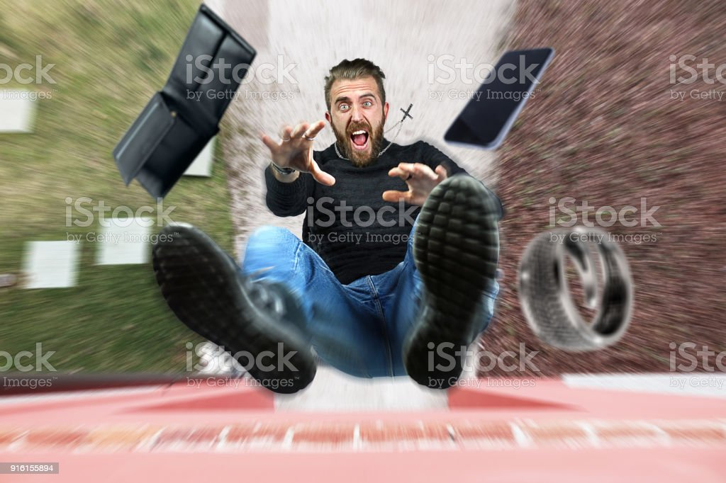 Man falling from the roof - foto stock
