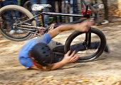 Man falls Off BMX Bike on Track.
