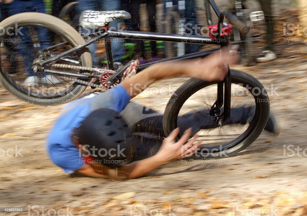 Man falling Off BMX Bike on Track stock photo