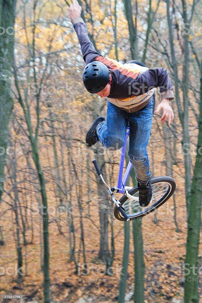 Man falling Off mountain bike on Track stock photo