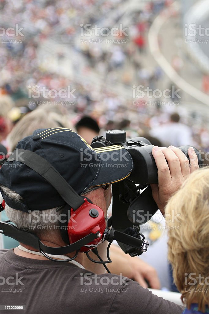 Man Fan at Racing Event With Binoculars royalty-free stock photo