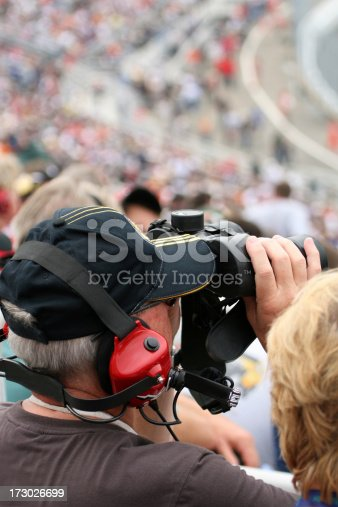 173015172 istock photo Man Fan at Racing Event With Binoculars 173026699